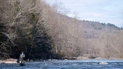 Nearing the end of the trip...the clouds coming it as Bob floats thru on of the final rapids. Housatonic River with HRCKC by Tom Hart.