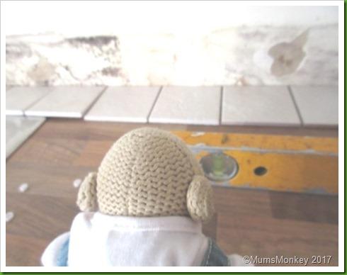 mens work tiling kitchen.