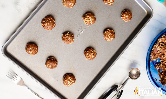 rolled cake batter cookies on a baking tray