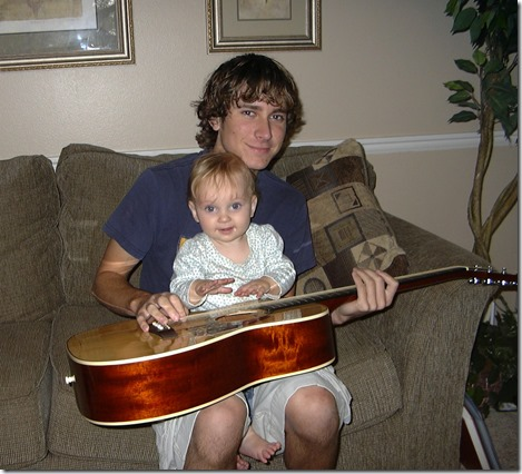 Landon teaching Halle the guitar
