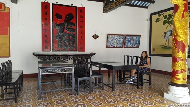 Resting in the shade of the assemble hall. Quang Trieu (Canton) Assembly Hall in Hoi An ancient town