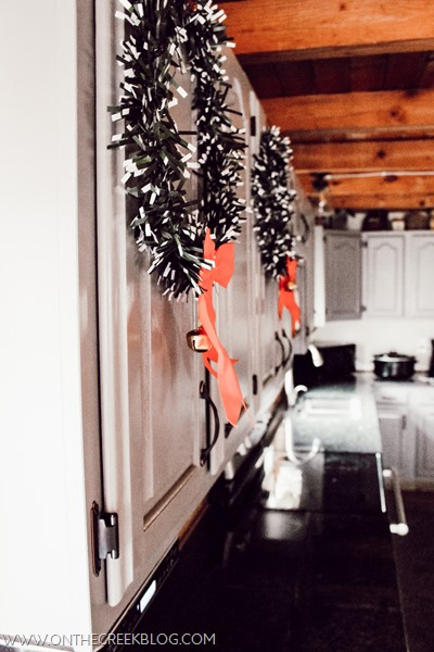 Christmas wreaths on kitchen cabinets