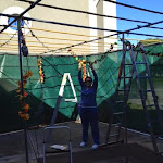 Elaine Hoffman decorating the sukkah.jpg
