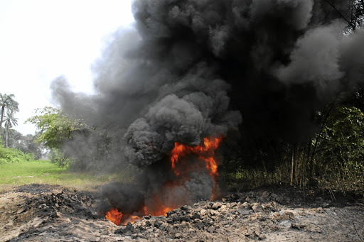 Fire burns on the Shell Petroleum Development Company Trans Niger pipeline at Mogho, Gokana in Rivers state, Nigeria. Picture: REUTERS