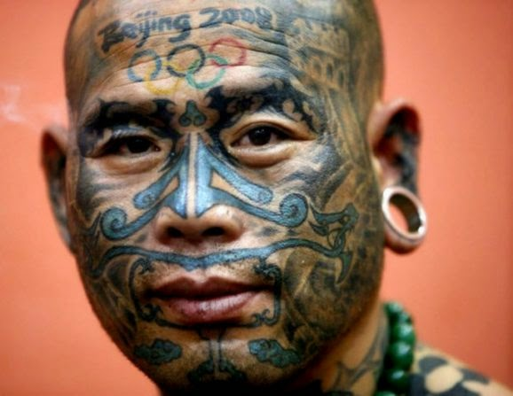 Crazzy Tattoos on Face  Best Tattoo 2014 designs and ideas for