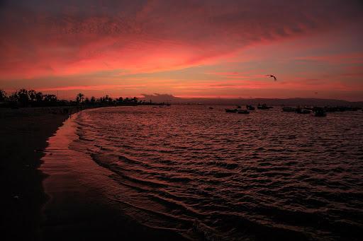 Sunset on Paracas beach in Peru.