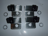 Special brackets to install plug covers on 1957-66 364-401-425 heads, requires 4 studded head bolts. 35.00