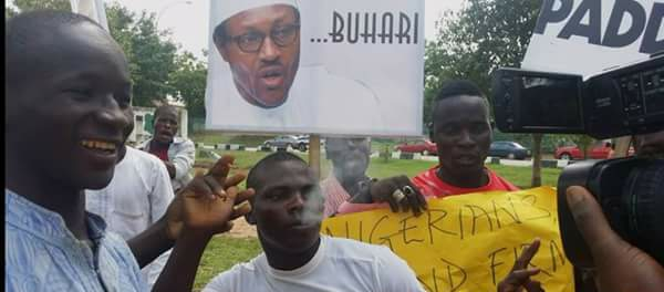 Buhari Supporters Pictured Smoking At Pro-Buhari Rally In Abuja (Photos)