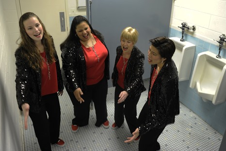 The Excel Quartet of the Vienna-Falls Chorus of Fairfax, Va., sings vocal warm-ups in the restroom, utilizing the great acoustics, April 2, 2013. The Excel quartet is the rookie quartet of the VF Chorus and is well on their way to success and great harmonies. (U.S. Air Force photo by Senior Airman Carlin Leslie)