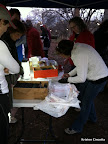 Intown 10K race volunteers handing out race packets.