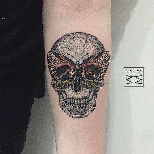 este_incrvel_borboleta_e_a_tatuagem_de_caveira