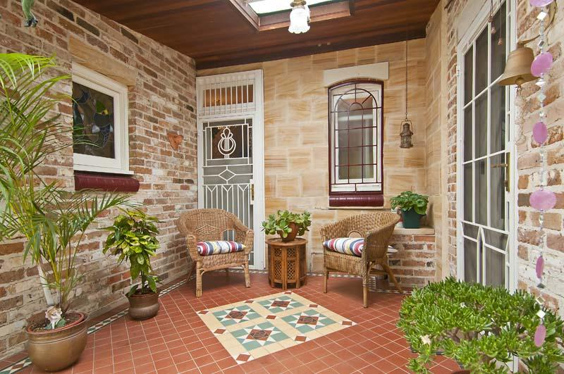 Beautiful leadlight window and door, outdoor furniture consistent with Federation style.