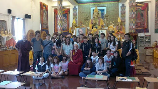 A group of 50 students from Taichung Ling-Dong Technology University visited Shakyamuni Center, Taiwan. They were given a tour of the center's 5-story building, ending in the gompa with a short discourse on Buddhism by resident teacher Geshe Ngawang Gyatso and translated by Ven. Yeshe Gyatso, October 25, 2011.