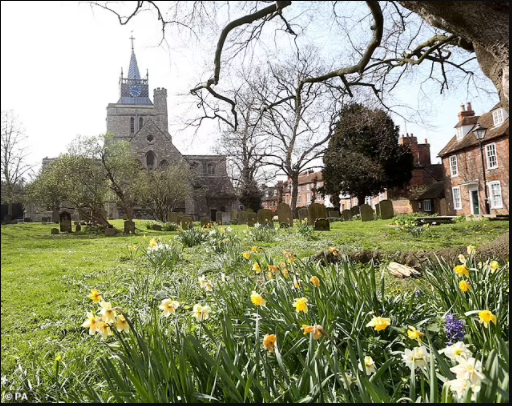 20-year-old woman is 'raped by Asian man in St Mary's Church churchyard