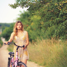The long way home by Hurghis Vasile - People Portraits of Women ( village, vintage, color, transportation, beauty, road, people, portrait, bicycle, country )