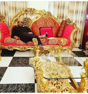 Emoney shows off his luxurious gold apartment