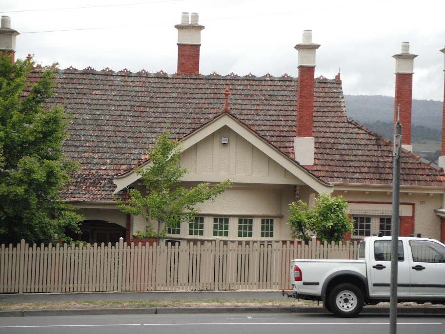Complex ridge capping and ornamental chimney designs with asymmetrical gable at 119 Elphin Road Newstead Launceston