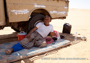 While I explore the dunes, Muhammad assumes his qat-chewing cigarette-smoking position all day in the shade of the truck.
