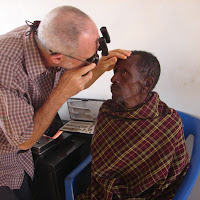 Dr. Savage examining eye patients during the Monday screening.