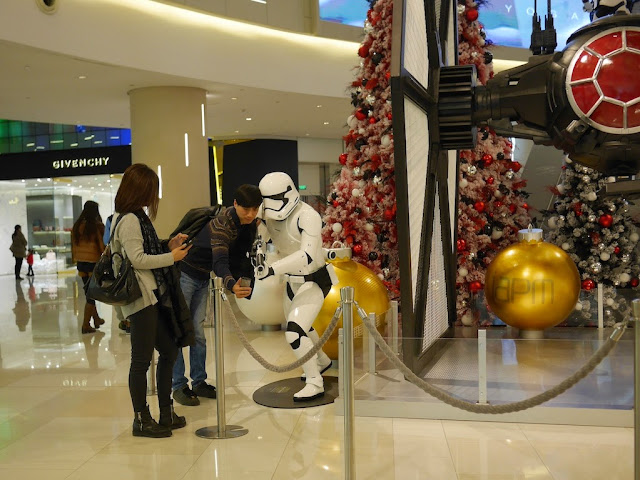young man taking a selfie with a Star Wars Stormtrooper at the IAPM shopping center in Shanghai