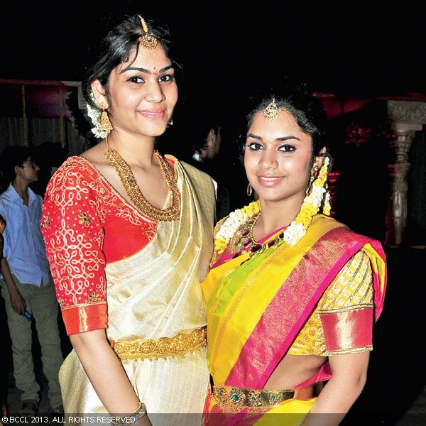Riddima and Shravya pose for the shutterbugs during Hitesh Chenchuram and Sri Puja's wedding ceremony, held in the city recently.
