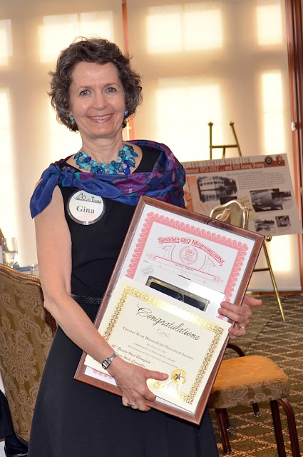 Gina accepts the Greater West Bloomfield Historical Society Community Achievement Award, 2014