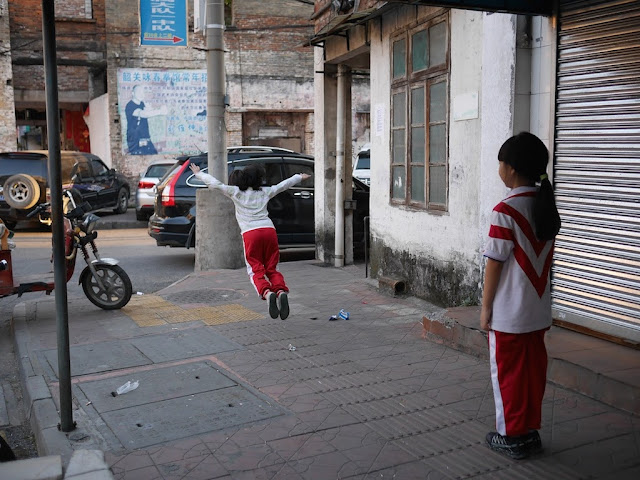 girl leaping forward in a game in Shaoguan, Guangdong