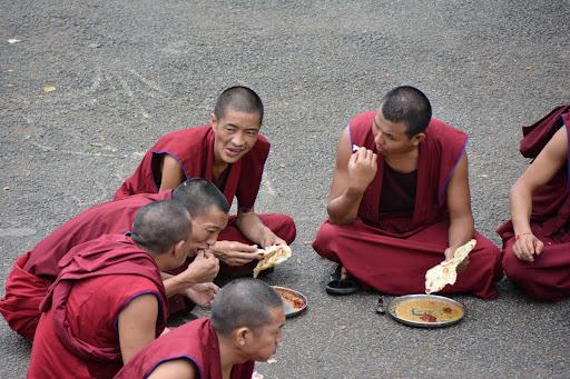Monks enjoying lunch.