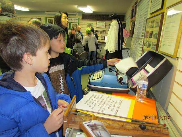 Youngsters get a kick out of the typewriter!