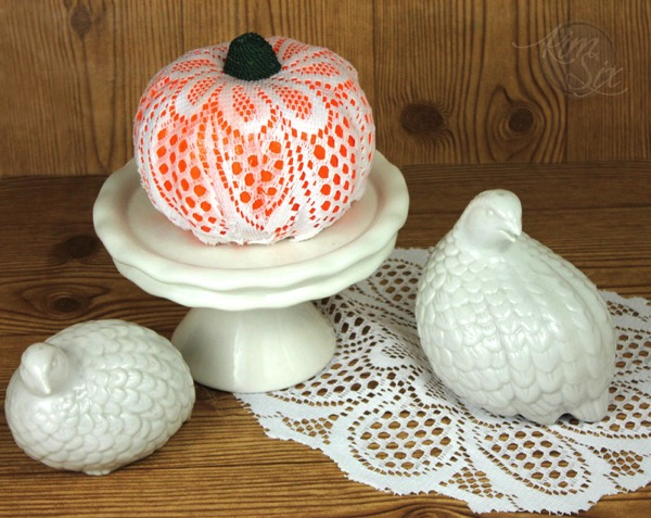 Wrapping a lace doilie on dollar store pumpkin