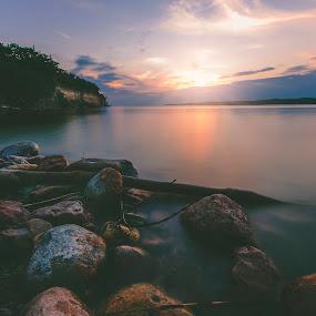 Lewis by Chris Timmerman - Landscapes Sunsets & Sunrises ( sunset, summer, beach, landscapes, nebraska, rocks, sun, suns rays,  )