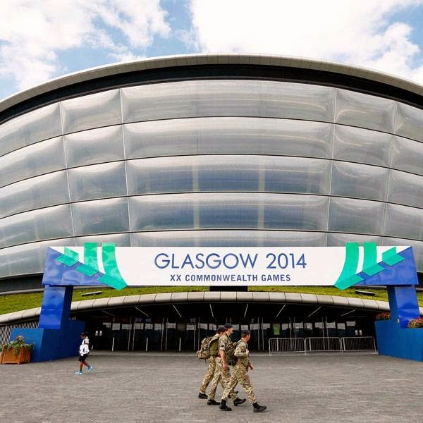 Soldiers walk past the Hydro Arena ahead of the Commonwealth Games in Glasgow July 22, 2014.