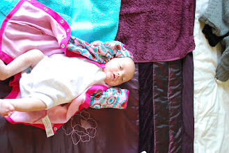 Photo: Adèle trying newborn size clothes