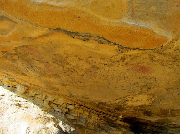 Faint pictographs under an overhang