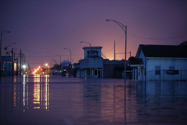 PORT ARTHUR, Texas, 31 August 2017: A flooded street is seen after the area was inundated with flooding from Hurricane Harvey on 31 August 2017 in Port Arthur, Texas. At least 37 deaths related to the storm have been reported since Harvey made it's first landfall north of Corpus Christi, 25 August 2017. Photo: Joe Raedle / Getty Images