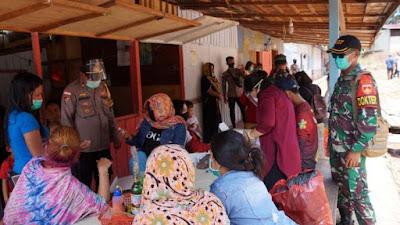 TNI-Polri dan Dinas Kesehatan Sosialisasikan Protokol Kesehatan di Perbatasan