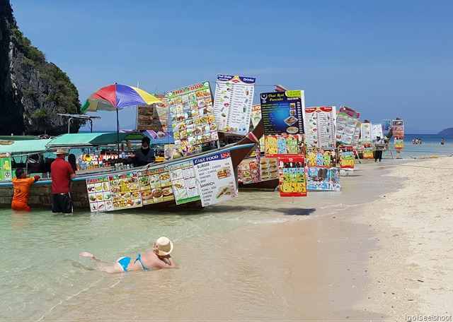 """""""food boats"""" at Phra Nang Beach that sells a variety of food and drinks at reasonable prices. These included Thai food, fast food (Burgers, Sandwiches, Baguette, Kebabs), BBQ, seafood, fruits, shakes, cold and hot drinks etc."""