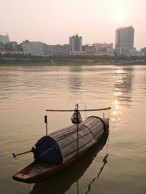 small boat in the Xiang River near sunset in Hengyang, China
