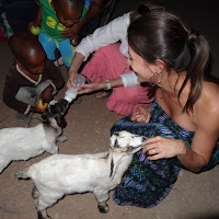Maria loves the baby goats at the house next door