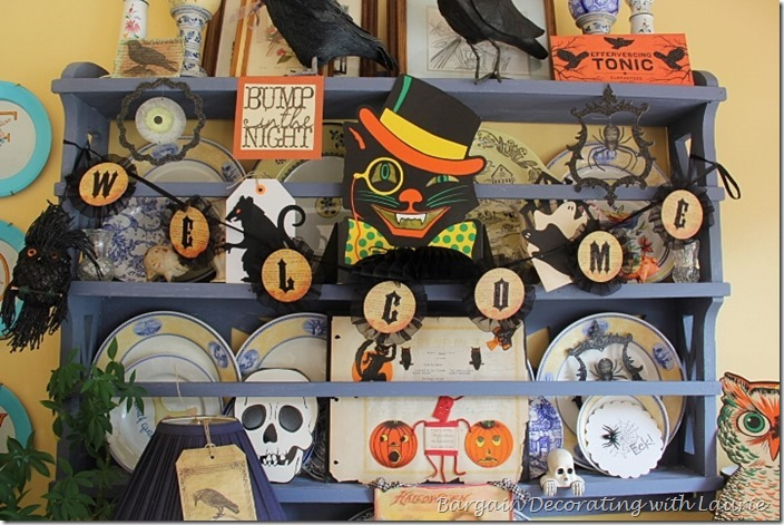 Halloween Decor on sunroom plate rack