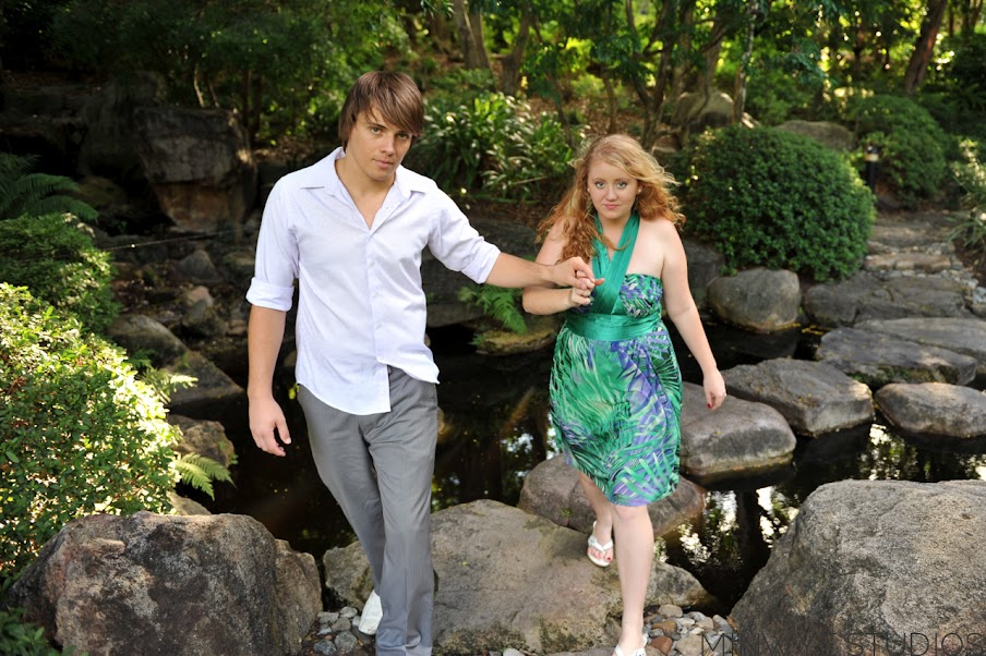 David leading Lisa across stepping stones at the Japanese Gardens in Mt Coot-Tha Botanic Gardens, Brisbane
