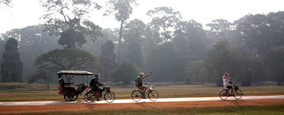 People riding bicycles in Siem Reap Cambodia