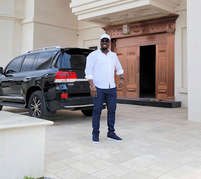 Obi Cubana with his car