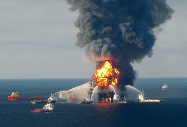 Fire boats battle the blazing remnants of the off shore oil rig Deepwater Horizon, off Louisiana, in this 21 April 2010 handout file photo. Photo: U.S. Coast Guard