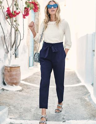 lady wearing elegant navy paperbag pants