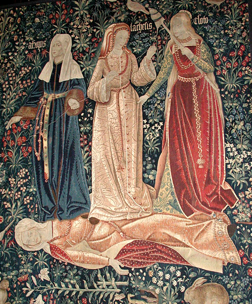 The Triumph of Death, or The 3 Fates. Flemish tapestry (probably Brussels, ca. 1510-1520). Victoria and Albert Museum, London. The three fates, Clotho, Lachesis and Atropos, who spin, draw out and cut the thread of Life, represent Death in this tapestry, as they triumph over the fallen body of Chastity. (Wikipedia 23 April 2014)