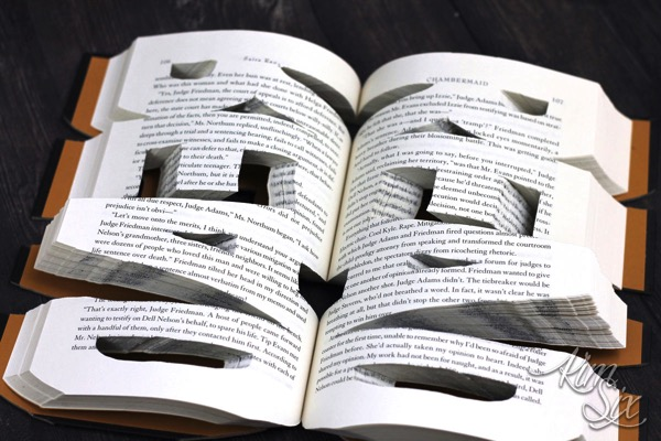Letters cut out of hardcover book