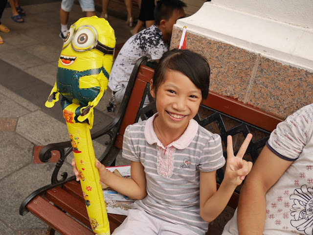 young girl with a PRC flag and Minions balloon in Zhongshan, China