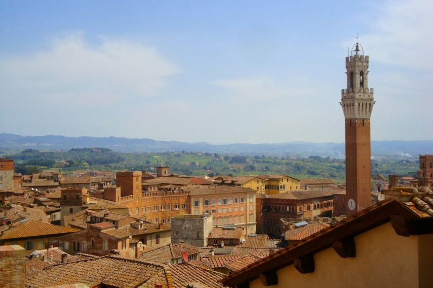 La Torre del Mangia, the Tuscan hills and the roofs of Siena seen during the 'Porta al Cielo' visit