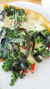 Pesto Pizza with spinach pesto, mozzarella, fontina, ricotta, tomatoes, basil by Dove Vivi with that famous cornmeal crust